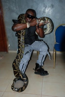 charly boy and his pet python