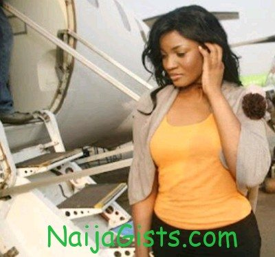 omotola jalade falls down airport picture