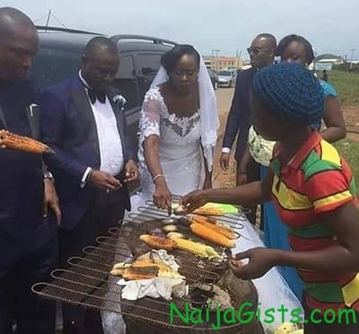 newly married couple buying roasted corn