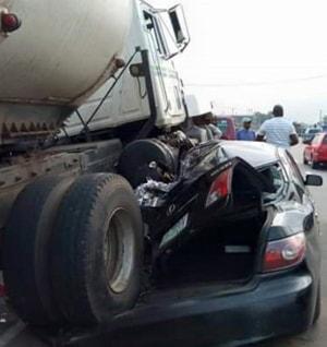 fuel tanker crushes car occupants survives