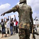 nigerian soldier abusing civilians