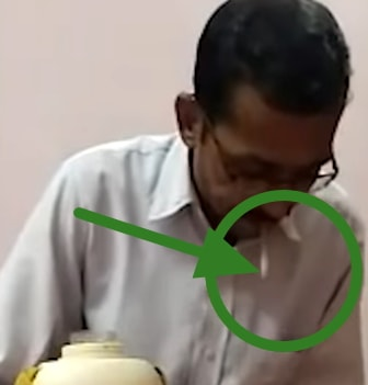 indian man spits into boss glass water