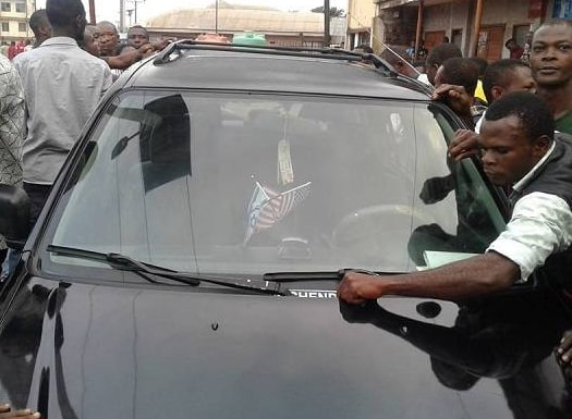 pastor flees church members car