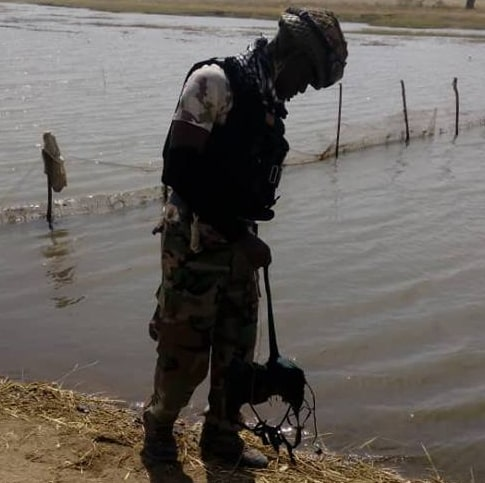 suicide bombers throw vest into river soldiers