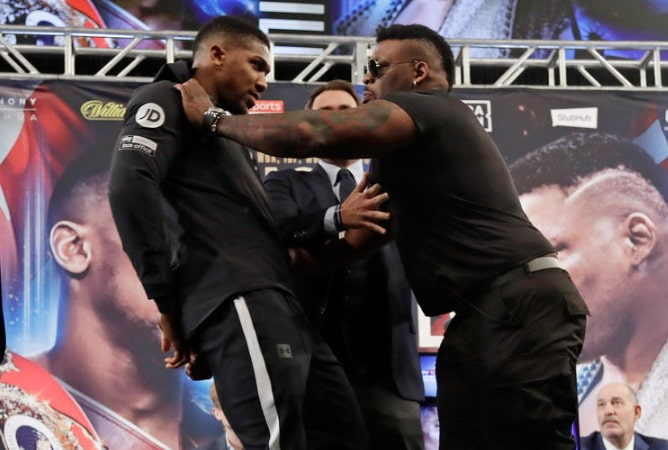 jarrell miller pushes anthony joshua