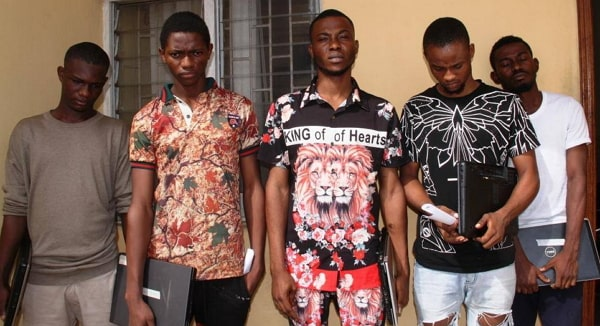 yahoo boys with laptops arrested