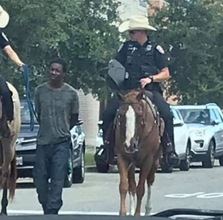 policemen tied black man to horses