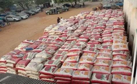 buhari distributes seized rice nigerians